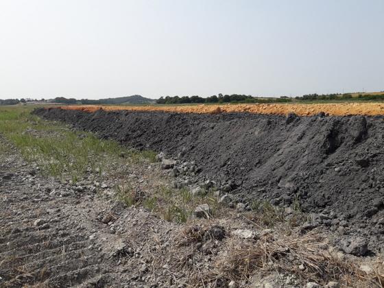 화석연료재인 버틈워시 매립 (사진 = 윤시현 기자)