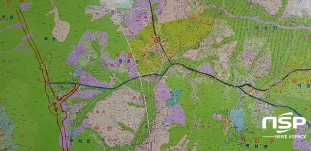 부동산중개업소 벽에 붙어진 지도. (사진 = 김병관 기자)