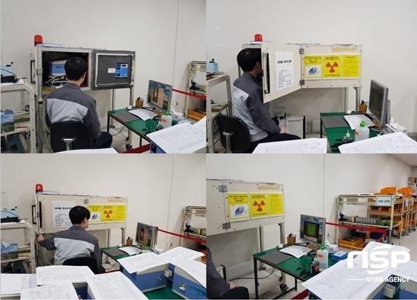 서정초 학부모 대책위가 문제를 삼고있는 포스콤의 차폐시설 안에서 포스콤의 생산직 직원이 원자력 안전법에 근거한 메뉴얼대로 포스콤의 휴대용 X-Ray 제품의 방사선 발생장치를 테스트하고 있다. (사진 = 강은태 기자)